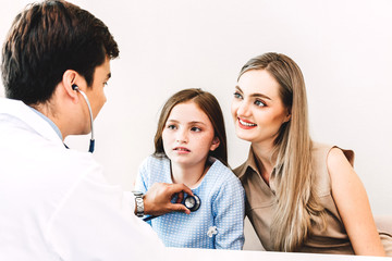 Doctor examining little girl with stethoscope in the hospital.healthcare and medicine