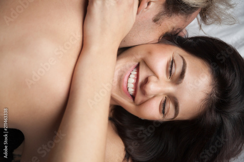 Young Husband Hugging And Kissing Beautiful Wife Enjoying Romantic Sensual Moment Together Having Pleasant Passionate