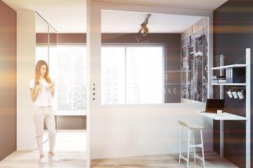 Gray empty home office interior, freelance, woman
