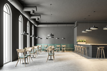 Industrial style cafe interior, green sofas