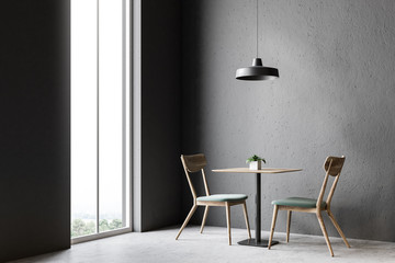 Two chairs and a table, gray wall cafe interior