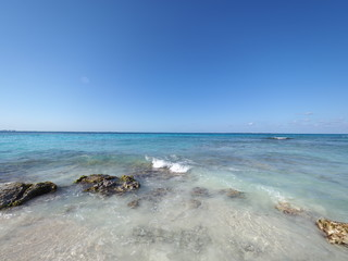 Seascape panoramic view of turquoise waters of Caribbean Sea landscape with horizon line at Cancun city in Mexico