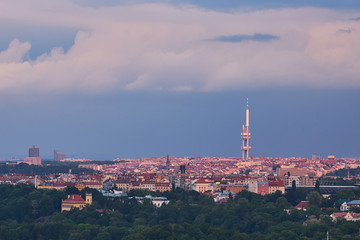 Landscape or cityscape Picture of Prague television tower in Zizkov quarter taken in summer evening before storm with heavy dark blue clouds. Modern prague architecture.