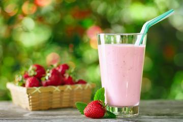strawberry milkshake in glass on table