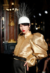 A model presents a creation by designer Ronald van der Kemp as part of his Haute Couture Fall-Winter 2018/2019 fashion show for fashion house RVDK in Paris