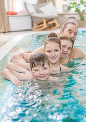 big family having fun in the pool