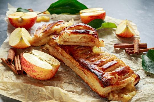 Freshly baked Apple and cinnamon strudel on baking paper