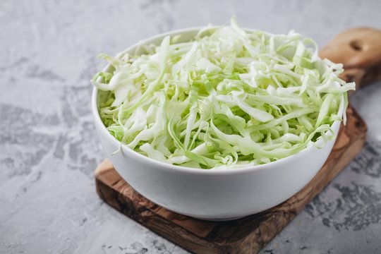 Fresh green cabbage cut. Sliced cabbage in bowl