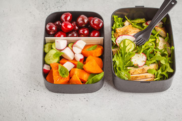 Healthy meal prep containers with grilled chicken with salad, sweet potato, berries, fruits and vegetables. Copy space, white background.