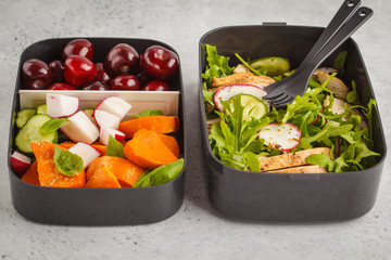 Healthy meal prep containers with grilled chicken with salad, sweet potato, berries, fruits and vegetables, macro.