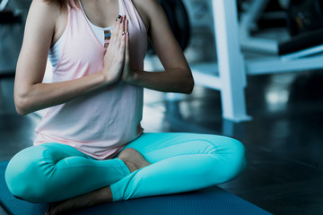 attractive woman exercise schedule time in gym workout with yoga lesson