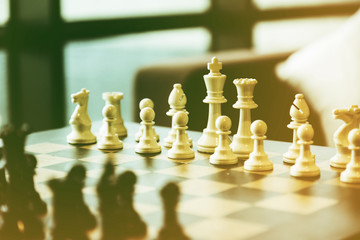 business  game competitive strategy with chess board game with blur background