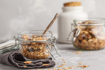 Homemade oat granola in glass jars. Healthy food concept.