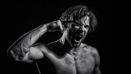 Angry guy. Aggressive emotions. The man's face close-up. Self-affliction, criminal and violence. The man opened his mouth and screamed. Beautiful Angry Man