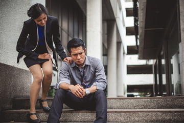 Woman Consoling upset asian businessman tired from work unemployment, fired from job, disappointed, loss and feeling down, consolation concept
