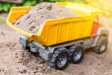 children's toy truck with sand. concept of transportation of goods and building materials