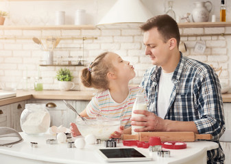 Happy family cooking together in kitchen