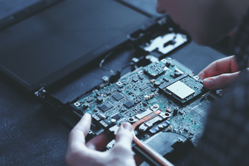 computer hardware development. microelectronics technology science concept. engineer holding modern motherboard