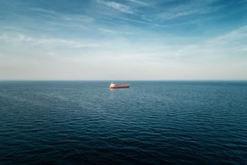 Cargo ship sailing in still water near port of Varna