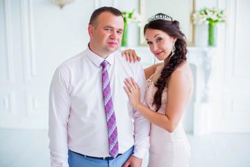 Portrait of wonderful wedding couple, bride put her hand on groom shoulder