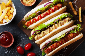 Barbecue grilled hot dog with sausage and yellow mustard with ketchup top view. Traditional american fast food.
