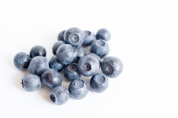Forest blueberries on a white background close up, soft focus. Summer wild berry
