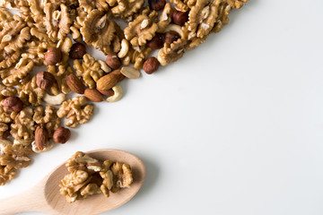 Walnuts, hazernuts, almond and cashew on a white background. Copy space. Selective focus