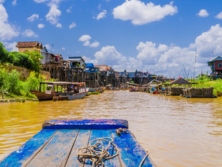 Exotic Kampong Phluk floating village with stilt houses and multicolored boats, Tonle Sap lake, Siem Reap Province, Cambodia