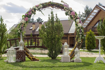 Decorated wedding ceremony arch. Wedding site. Love.