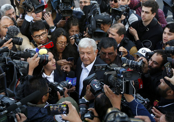 Candidate Obrador with media after casting his ballot at a polling station during the presidential election in Mexico City