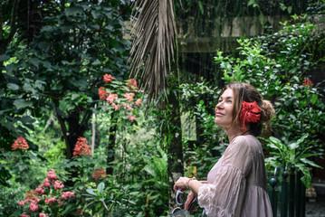 Beautiful woman enjoying the view of the jungle