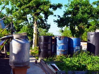 Barrels of water. Garden plot. Village. Flask. Life in the village. Plant cultivation.