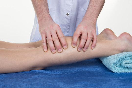 calf massage of a young pretty slim girl