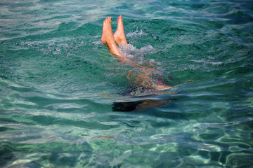 Little girl enjoying snorkeling in beautiful Croatian sea