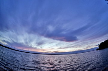 dark blue and orange evening sky over the lake, fish-eye
