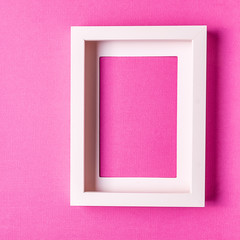 Abstract minimalism colofrul paper background with empty picture frame.