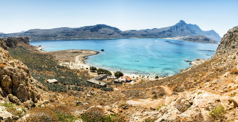 Panorama: Balos Lagoon Turquoise and Blue sea, view from the cliff of the island fort, Crete Island, Greece