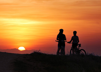 Mountain bikers at sunset