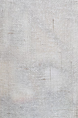Full frame background of a white lacy textile or curtain