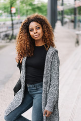 Portrait of young black woman wearing grey sweater