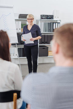 Businesswoman or team leader giving a talk