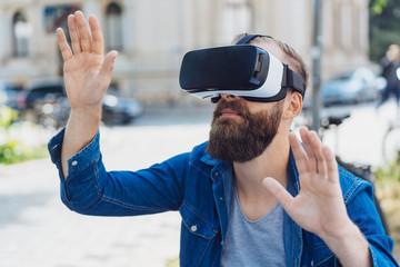 Bearded man using a 3d virtual reality headset