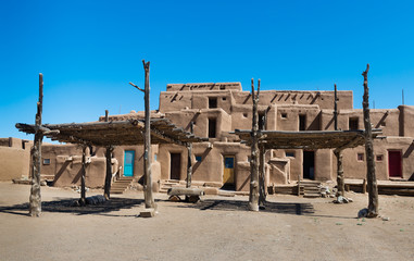 Adobe Buildings with Shade Structures. Taos Pueblo, New Mexico, continuously inhabited for over 1000 years.