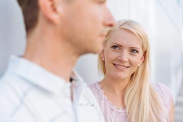 Loving young woman watching her husband