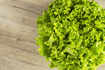 lettuce salad on a rustic background. Organic food. Top view. Macro. Copy space.