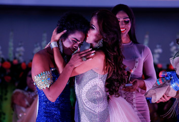 Newly crowned Miss Gay Daniela Simons is embraced after being winning Miss Gay Nicaragua 2018 pageant in Managua
