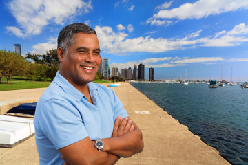 Handsome Hispanic man in a downtown urban waterfront setting