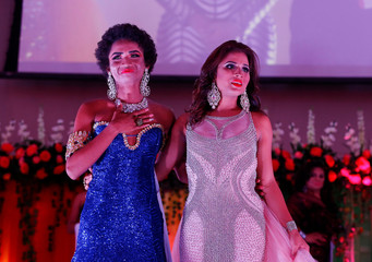 Newly crowned Miss Gay Daniela Simons (L) reacts after winning Miss Gay Nicaragua 2018 pageant in Managua