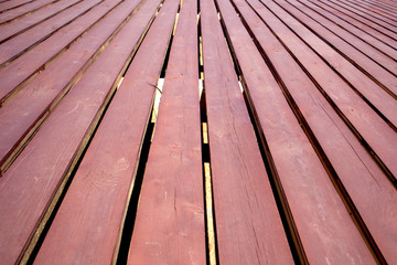 Wooden deck of painted planks with slots, may be used as background or texture