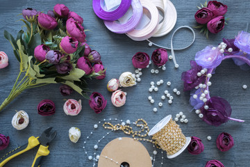 Making a artificial flowers and wreath for wedding decorating. Tools and accessories for creating on table, top view.